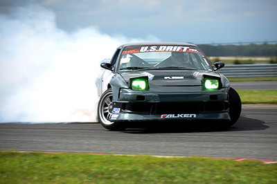 The U.S. Drift competition after the ARCA race at NJMP was pretty cool. Please note that the headlights were turned on and they were green. The car is traveling more or less in a straight line - towards the driver's left.<br /> <br /> ©Sam Feinstein