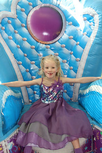 Birthday girl in the inflatable birthday throne