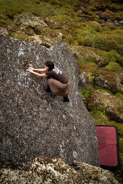 A high crux gives Sandra pause as she considers the mantle move to the topout.