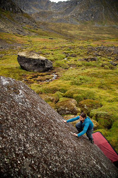 With the crux behind her, Amy moves for the topout up a slippery slime-covered slab.