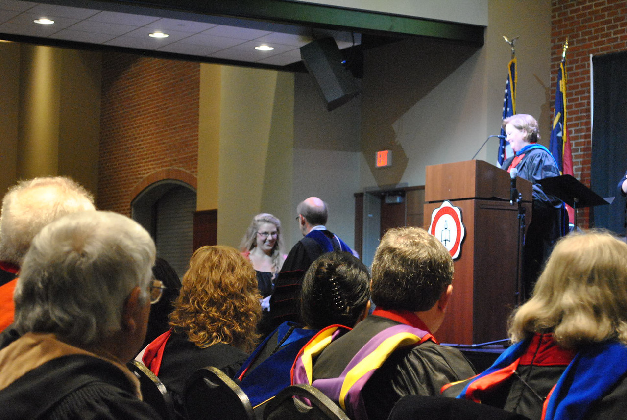 Student Katie Harte receives an award during the 2013 academic award ceremony.