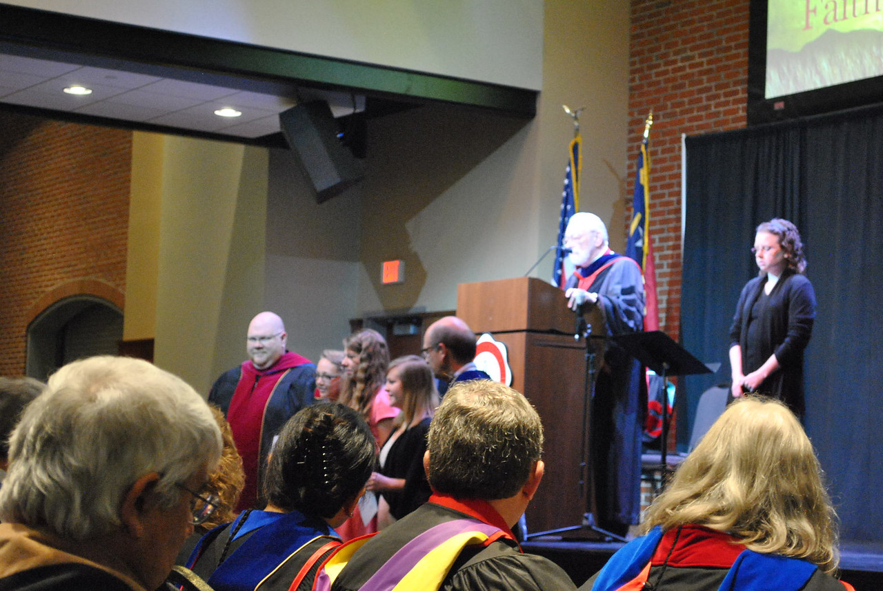 Students receive an award for their photography at the 2013 academic awards.