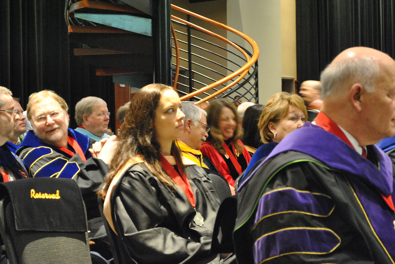 Professors watch students receive awards at the 2013 academic awards.