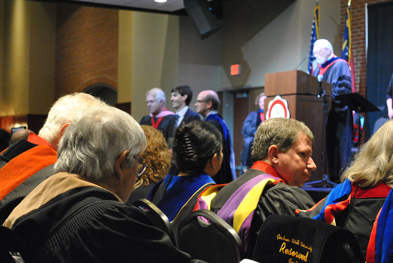 Professors watch as student Adam White receives the first year music award at the 2013 academic awards.