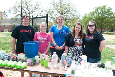 The Student North Carolina Association of Educators assist students in making recycled flower planters during the Earth Week Fair on Thursday April 18, 2013.