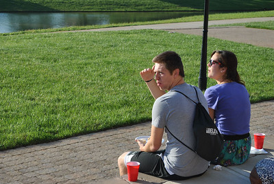 4-30-13: Students, Ben Parker and Meredith Comer, enjoy hot dogs at the Verg cookout celebrating the end of the year.