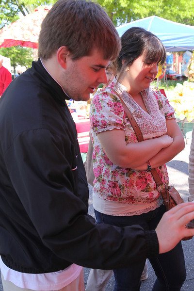Gardner Webb Students Carson Thompson and Andrew Slesinger visit the Farmers Market in downtown Shelby Saturday Morning as a part of Earth Week.