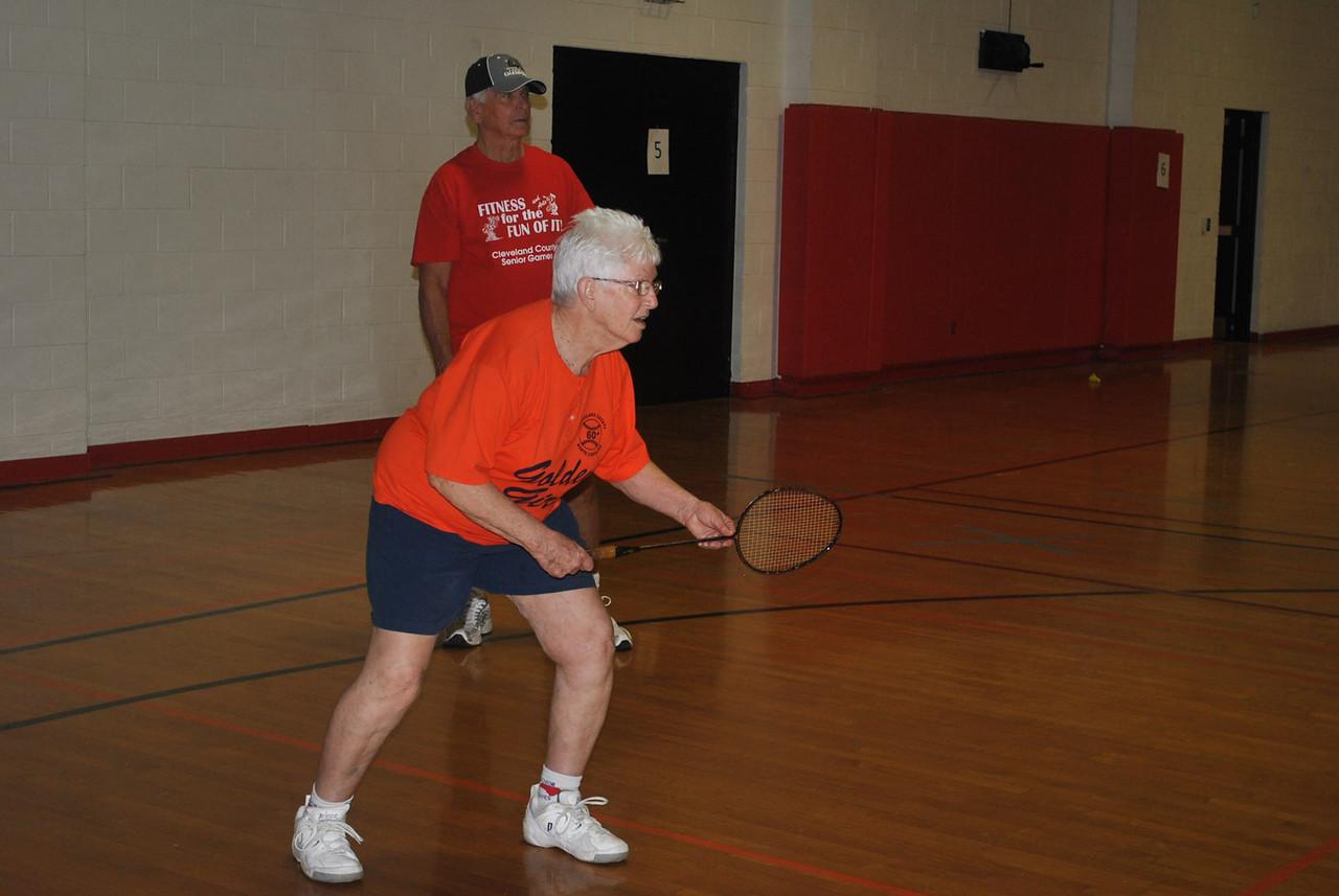 Some community senior citizens participate in the badminton event during the annual senior Olympics.