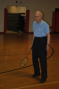 Some community senior citizens participate in the badminton event during the annual senior Olympics.