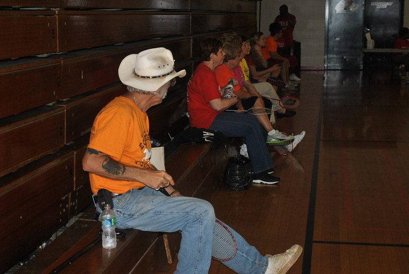 Some community senior citizens wait for their turn to participate in the badminton event during the annual senior Olympics.
