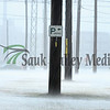 Rain pours and floods an area near downtown Rock Falls Wednesday afternoon.