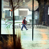 A pedestrian makes his way through the rainy streets in downtown Dixon Wednesday afternoon.