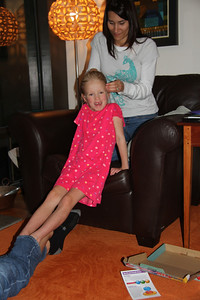 Amelia gets a fancy french braid from Micki! Keeping her feet warm inside Peter's pant leg. :)