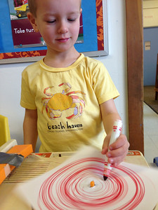 Connor doing some record player art at preschool