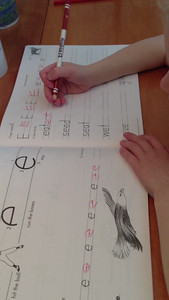 """Amelia has been working hard to retrain herself on how to write letters according to this """"Writing Without Tears"""" program. I was so happy to catch her in the act, unprompted. You can hear her (and Connor) talking through the letters."""