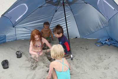 Our new beach umbrella, great for getting out of the wind