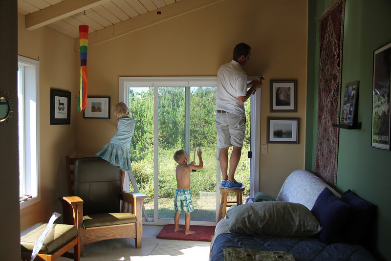 Installing the new drapes in the mystery room. Connor has a tape measure just in case.