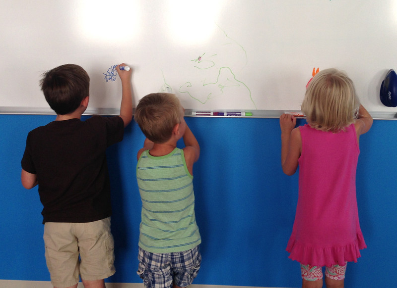 Checking out Daddy's whiteboard at the new office.