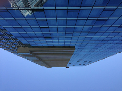 Opened by eyes while lying down at the pool and saw window washers swinging around above my head