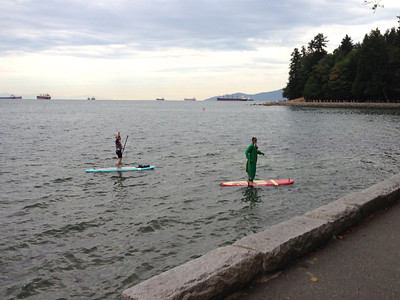 The only picture I took during the race. Paddleboarders dancing for us in Stanley Park. Racers as far as the eye can see.