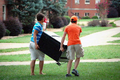 Two students moving a fridge across camps to their room for Orientation 2013.