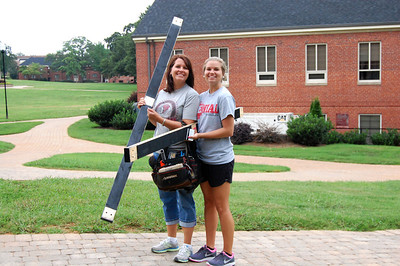 Parent and student moving in for Orientation 2013.