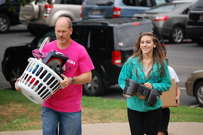 Dr. Tracy Jessup, a Bulldog Mover, helps move in a student for Orientation 2013.