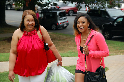 Parent helping their child move in for Orientation 2013.