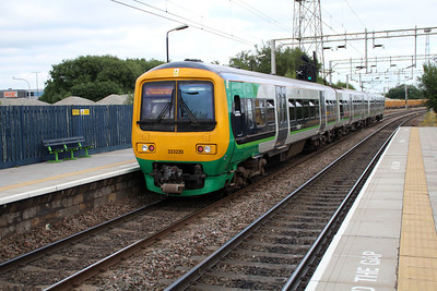323220 on a Walsall-Birmingham service at Bescot Stadium.