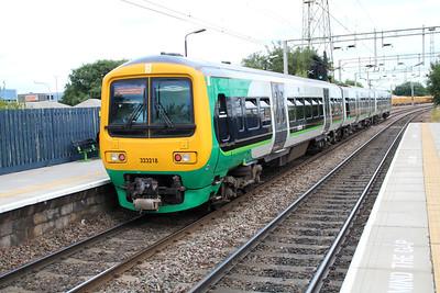 323218 on a Walsall-Birmingham service at Bescot Stadium.