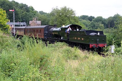 Steam 2-8-0 2857 passes Highley Museum on a service train.