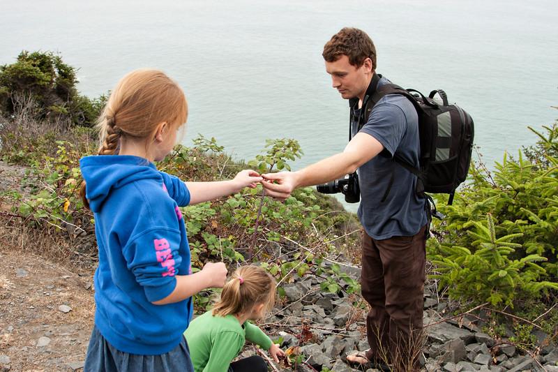 John handing his niece a blackberry.