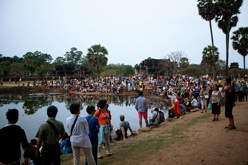 Hundreds of tourists flock to watch the sunrise at Angkor Wat.