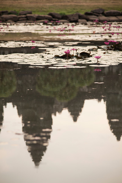 Angkor Wat reflected in a small pond as the day slowly chases away the night.