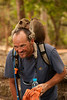 Monkeys frolic on Andy's shoulders after determining that he's not out to get them.