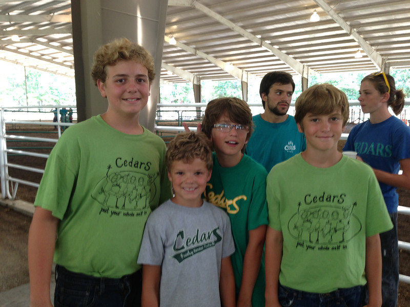 Post horse show.  Behind the boys is Elijah's counselor, Austin, and a cabin mate of Elijah's, Aidan.