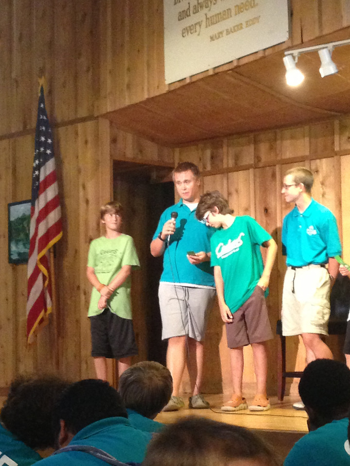 Stephen gives Evan his quality award.  Counselor Gage stands on the other side of Evan.