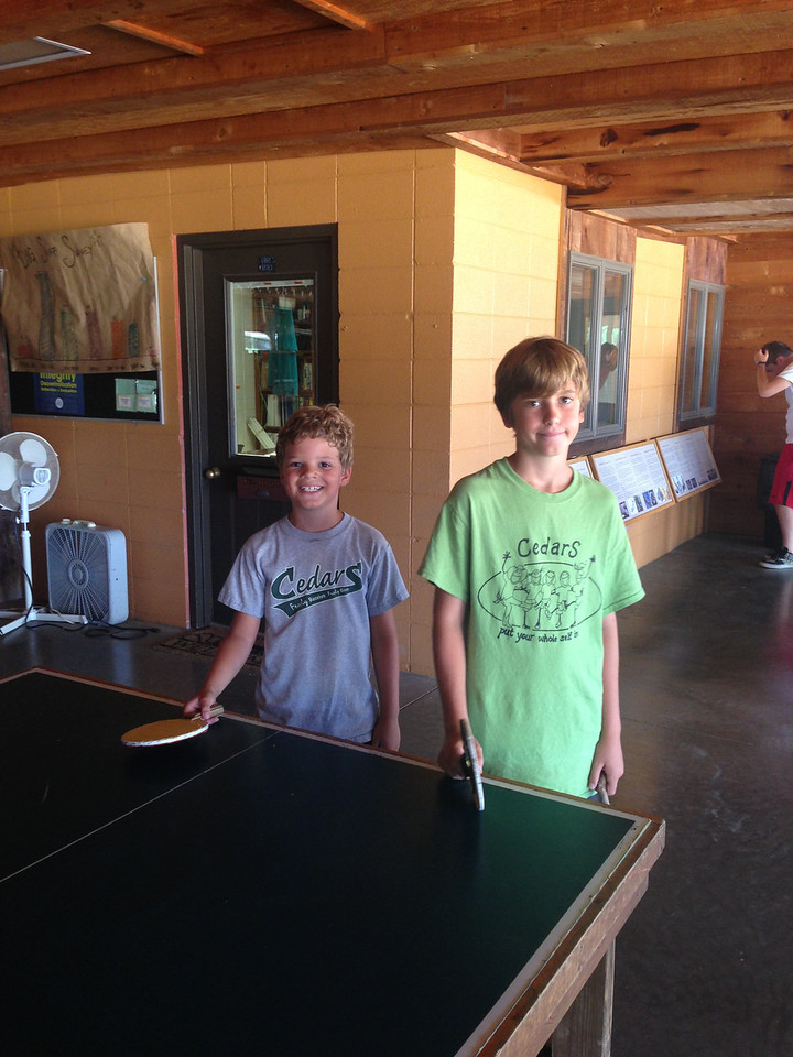 Preston and Josh enjoy ping pong before lunch and after the horse show.