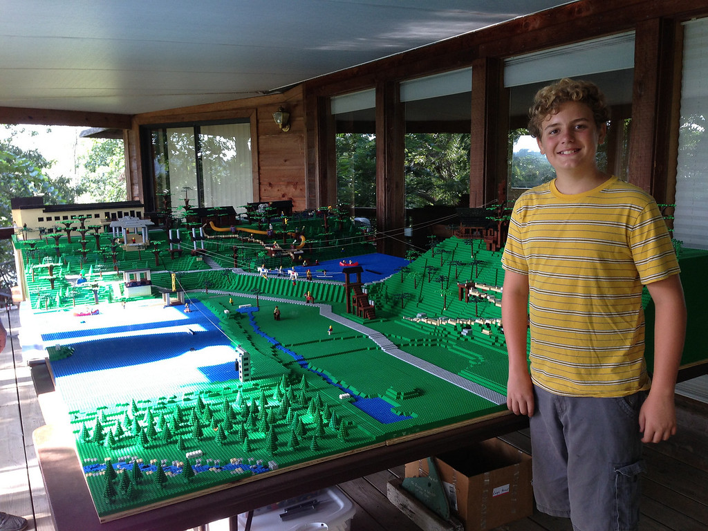 Elijah poses next to Cedars Camp in Legos!