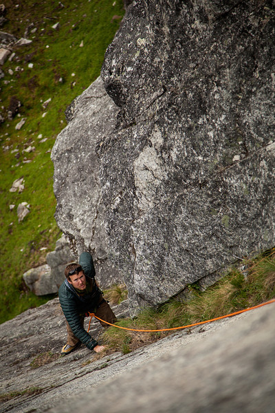 Matt glances upward at the belay from midway up the first pitch of <i>Rise 5.9</i>.