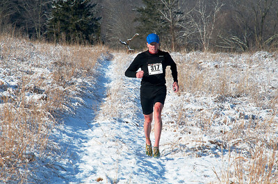 Gerry Sullivan finishing Gail's Trail Run (on the Loop course) at the Rez in 2009. Photo by Rob Cummings.