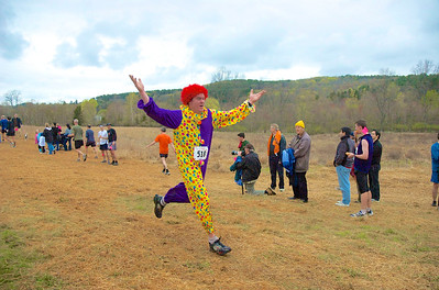 "Jim ""The Clown"" Funk crosses the finish line in 2008. Photo by Ciorsdan Conran."