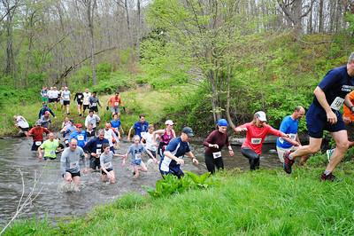 "Runners cross ""Sullivan's Surprise"" in 2012. Photo by Tom Casper."