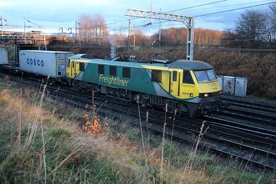 90045 0833/4L93 Basford Hall-Felixstowe passes Casey Lane Crewe.