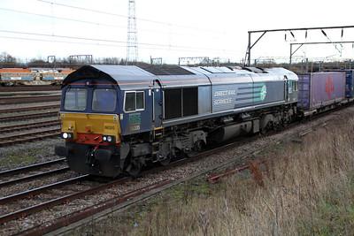 66305 1300/4S49 Daventry-Grangemouth passes Basford Hall Yard.