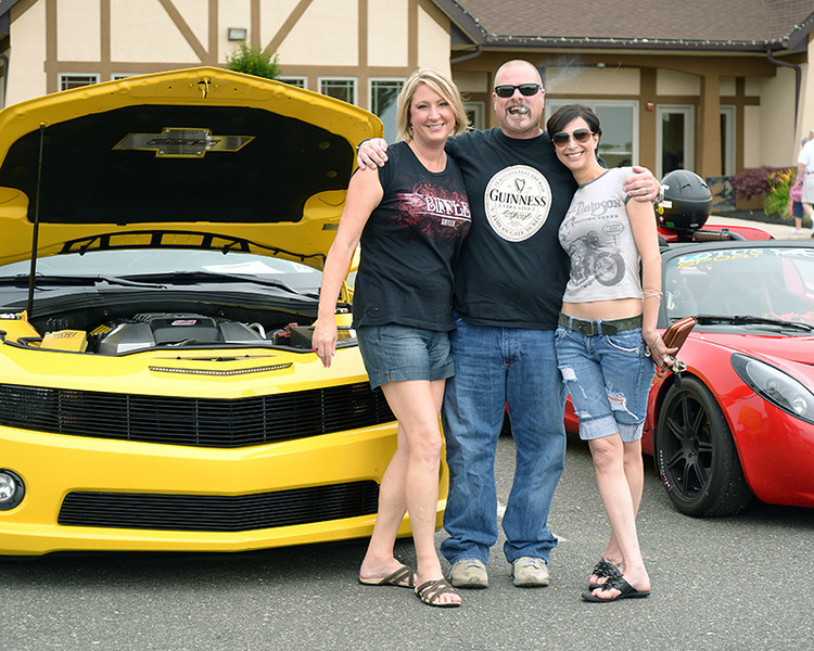 George Joyce, III, with some friends in front of his 2010 Camaro SS<br /> Photo by Sam Feinstein for NJMP