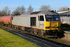 20 December 2013 :: 60099 lit superbly at  Newbury Racecourse Station  powering 6A11 from Robeston to Theale which was running 302 minutes late
