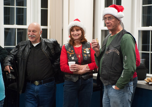 131202 Harley Christmas JOED VIERA/STAFF PHOTOGRAPHER Lockport, NY- Ben Antonio, Jude Wildhagen, and Paul Isham of the Harleys Owner Group smile and enjoy cookies and coffee as they watch the kid play at Wyndham Lawn on Monday Dec 2nd, 2013.