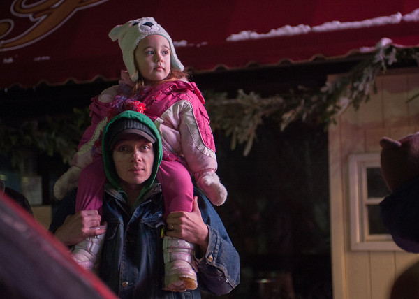 """131130 Parade JOED VIERA/STAFF PHOTOGRAPHER Lockport, NY-Alene Hagan(3) sits on top of her father Joe Hagen's shoulders watching floats go by at this years Christmas on the Canal """"Parade in the Dark"""" on Saturday Nov 30th, 2013."""