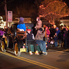 131206 Light up Newfane JOED VIERA/STAFF PHOTOGRAPHER Newfane, NY-Children greet the crowd while on the Purina Feed float during the Light Up Newfane parade on Main Street on Friday Dec 6th, 2013.